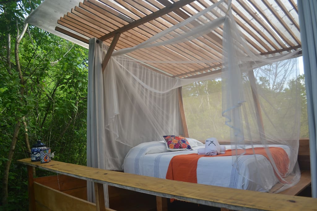 Comfortable Queensize bed, private shower, eco-toilet and hand sink inside the tent. Surrounded by nature in comfort.
