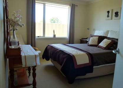 Comfortable bedroom in modern home in Napier