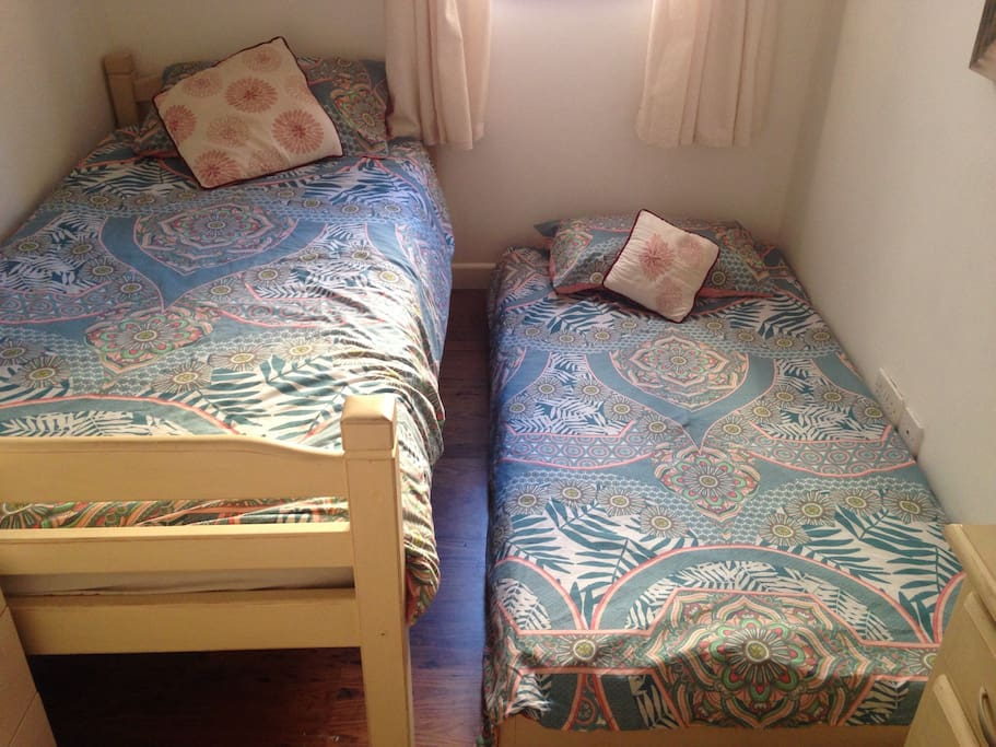 The space with two single beds in use.