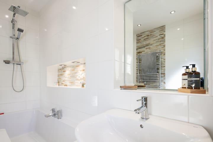 Bathroom with large shower bath.