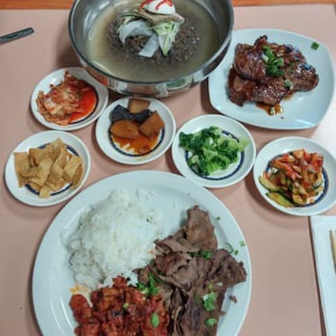 Ban Chan Restaurant, 3 minutes away.  Tasty Korean food, with all-you-can eat ban chan
