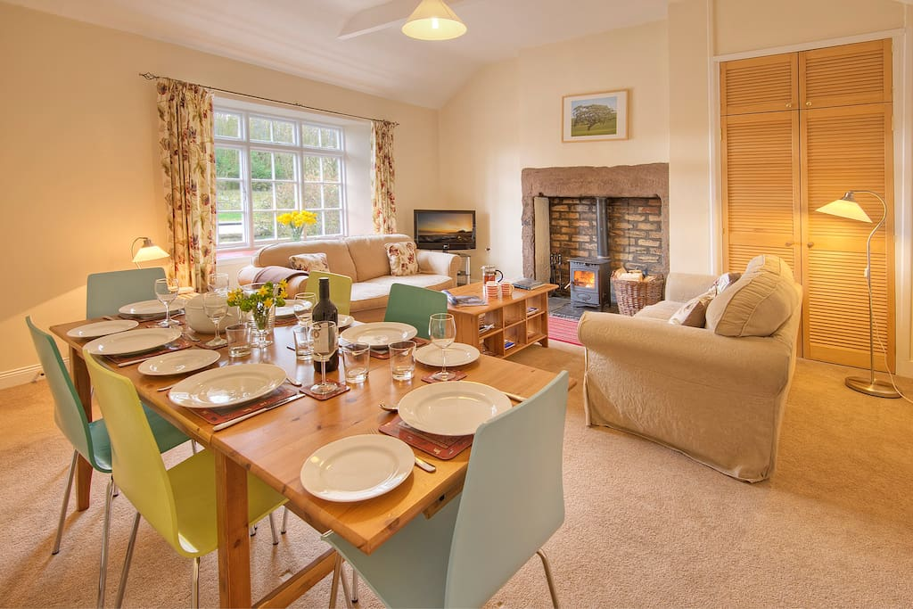 Cosy sitting room with a log burner, tv/dvd and dining area