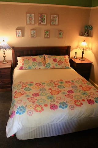 Bedroom 1- Queen size bed with solid latex mattress and Sheridan beddings