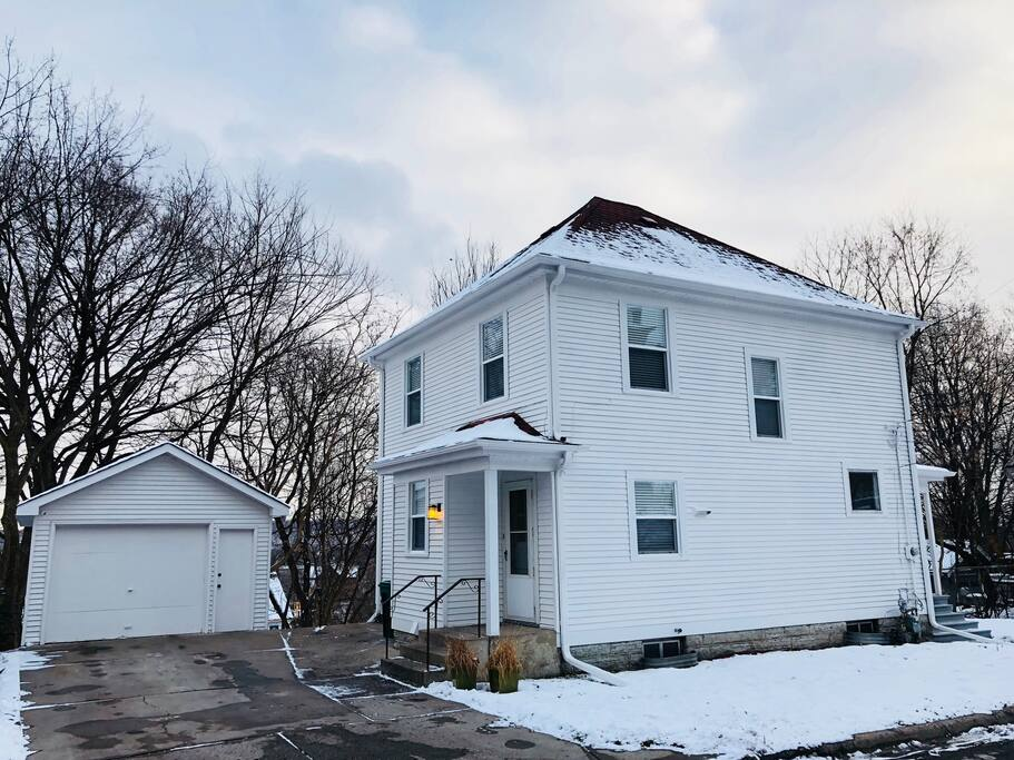 Entryway and garage of house. The modern spacious house is located in downtown Saint Paul and there are stairs conveniently located two blocks away to many great restaurants, shops, bars and Xcel Energy Center!