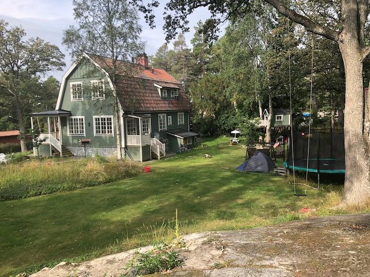 Dream house in a dream garden in a summer idyll