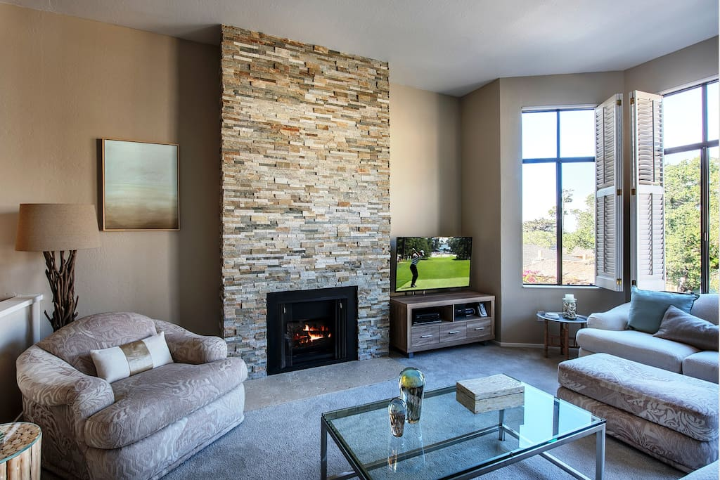 Hand-crafted gas fireplace made of stacked stone.