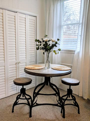 Small dinette table with seating for two.
