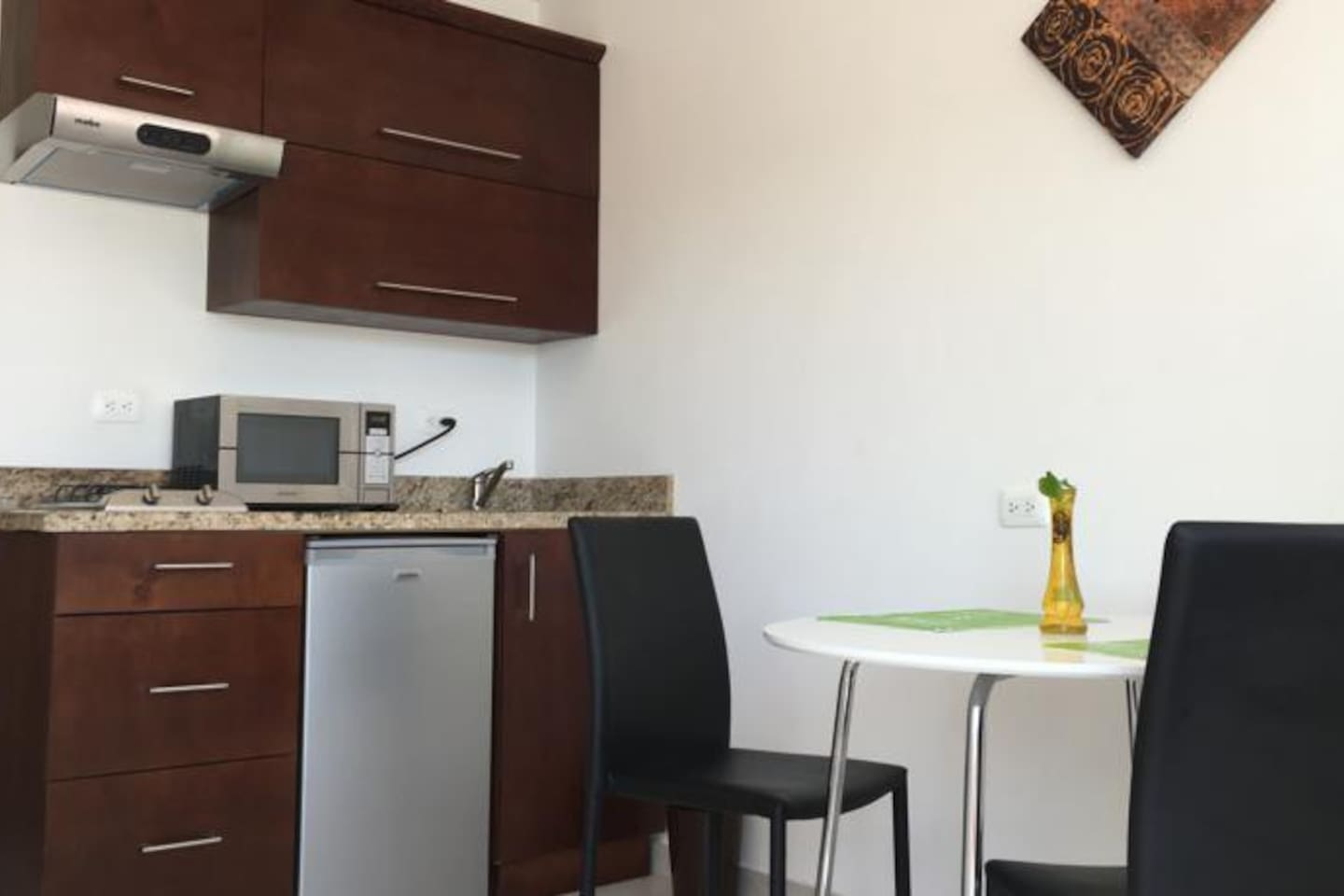 This beautiful new apartment has a kitchen, equipped with a microwave and Fridge and also has a table with two chairs to enjoy a great meal