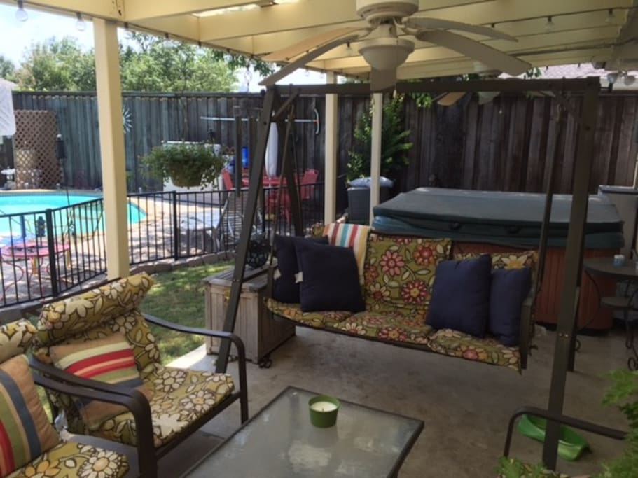 Relax under the covered patio (with lights and ceiling fans) or in the 7 person hot tub.