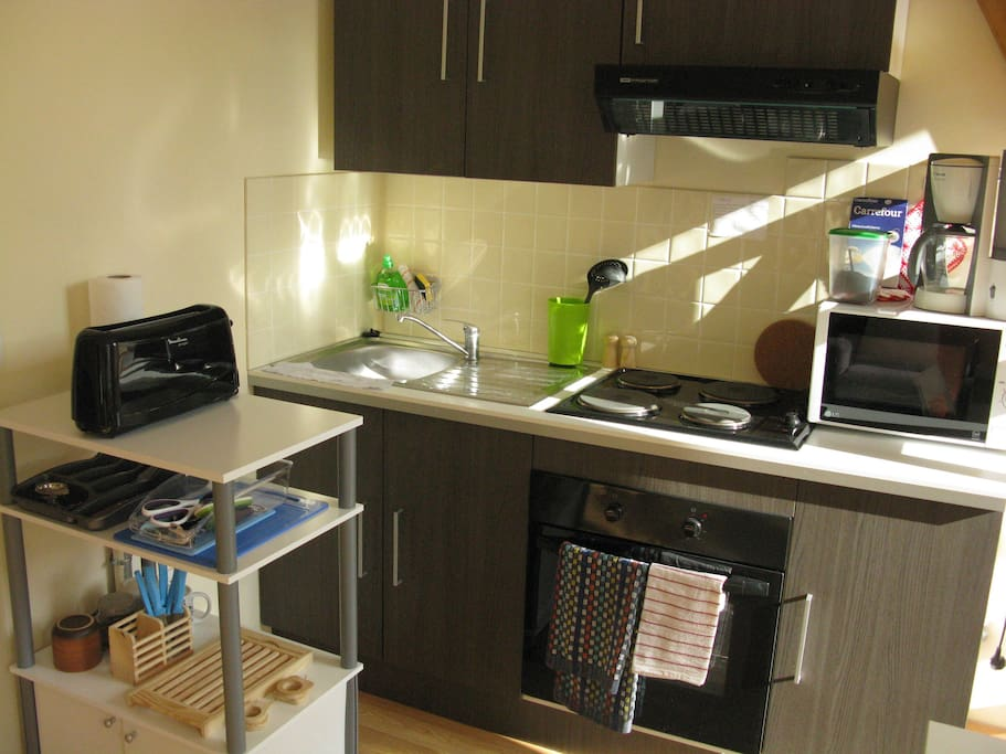kitchen area, with stove, oven, coffeemaker, kettle, toaster