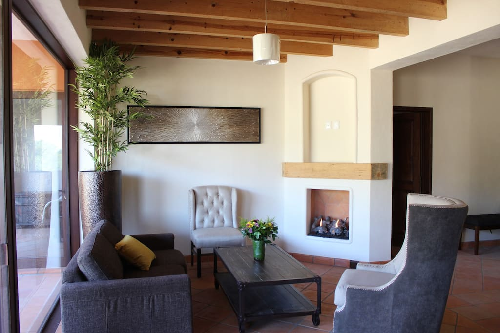 living room with a sofa bed for two kids and a chimney