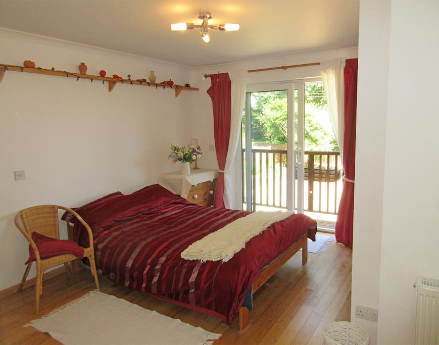 Double bed with chest of drawers and built-in wardrobe