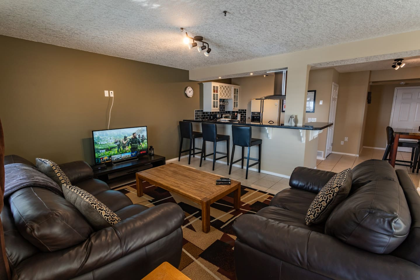 """Sit down and relax in quality leather sofas  for a movie night, watch the game or your favourite TV series marathon. The 50"""" HD SMART TV and bluetooth sound bar with subwoofer tops it off. NETFLIX is free of charge and pre loaded."""