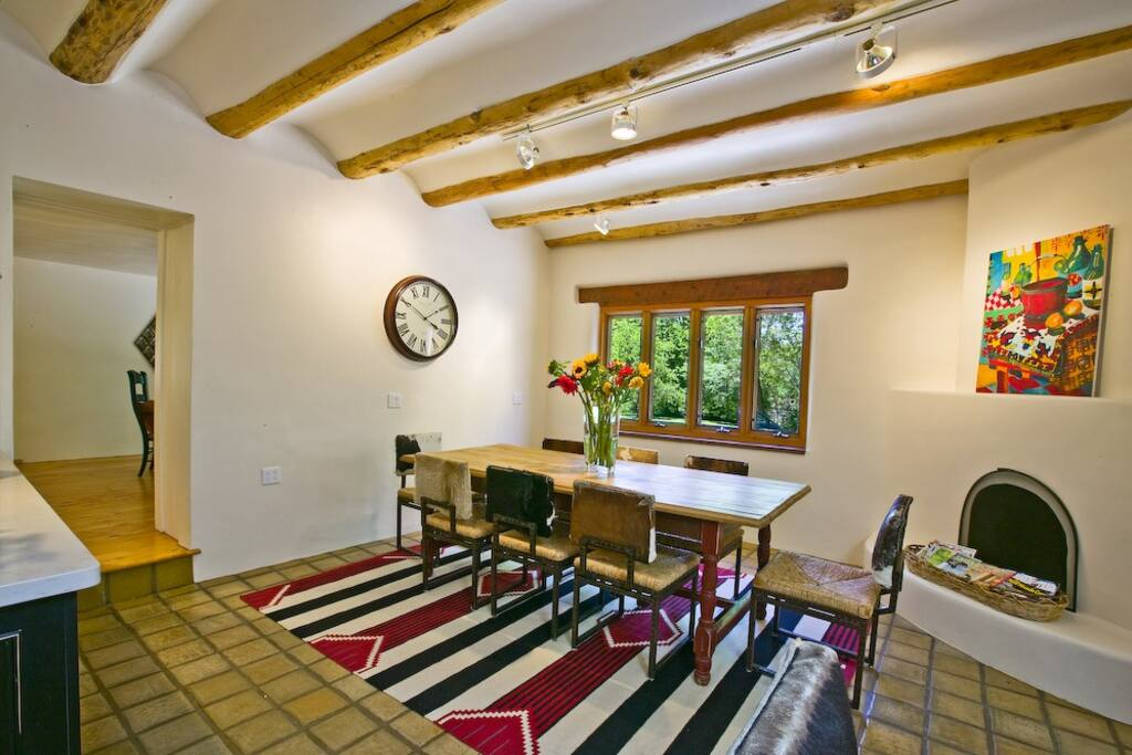 The heart of the house with Santa Fe style furnishings, hearth and beautiful coved plaster ceilings.