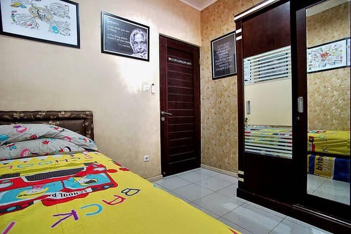 A warm and convenient bedroom