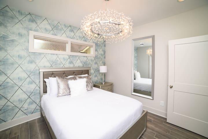 """Unit C: Bedroom 1   Main Floor. Queen Bed with pillow-top, 43"""" Smart TV, A/C, Closet. Next to Main floor Bathroom."""