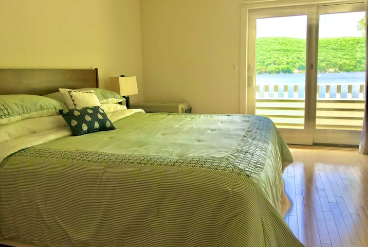 Top floor Master king bedroom. Amazing view . Slide the doors open - step out on your deck - just take a breath - life is wonderful