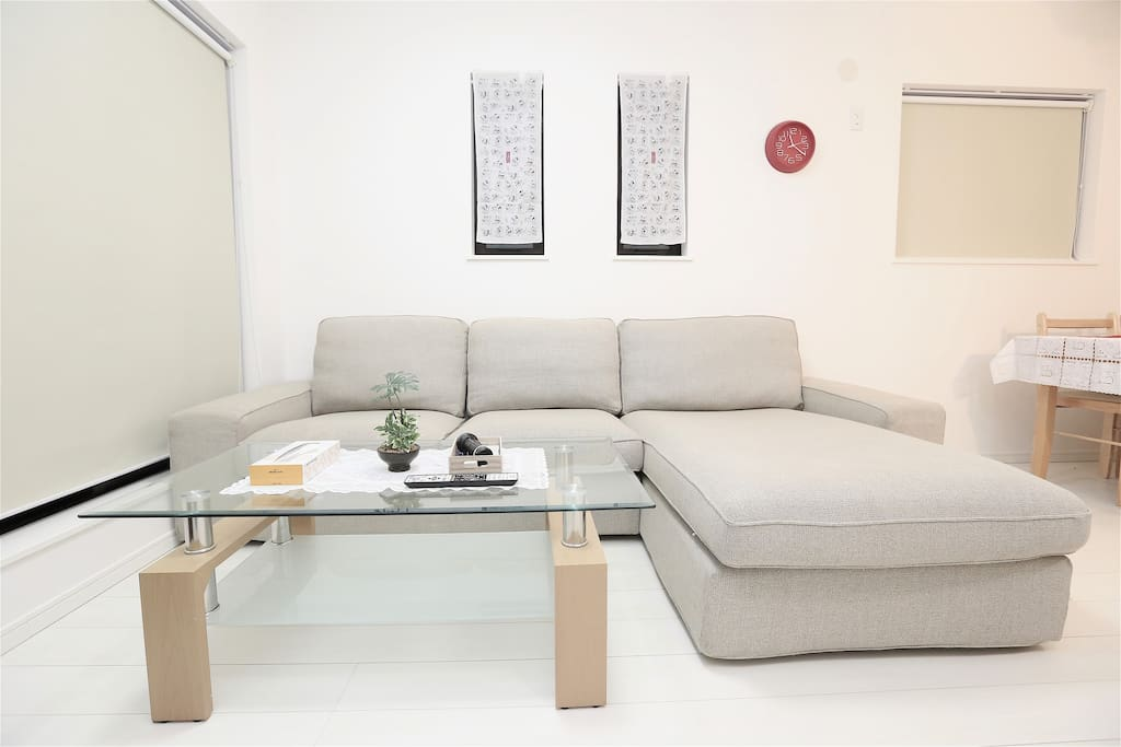 Giant L-shape sofa in spacious living room.