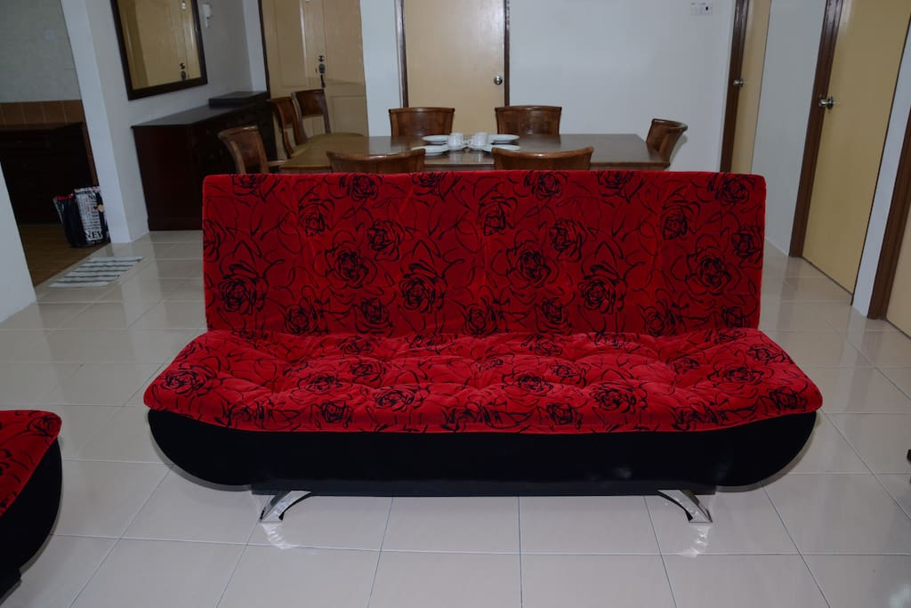 sofa bed and dining table