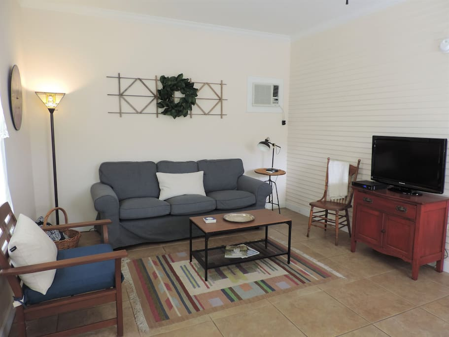 Relaxing living area featuring ample seating and a big screen TV