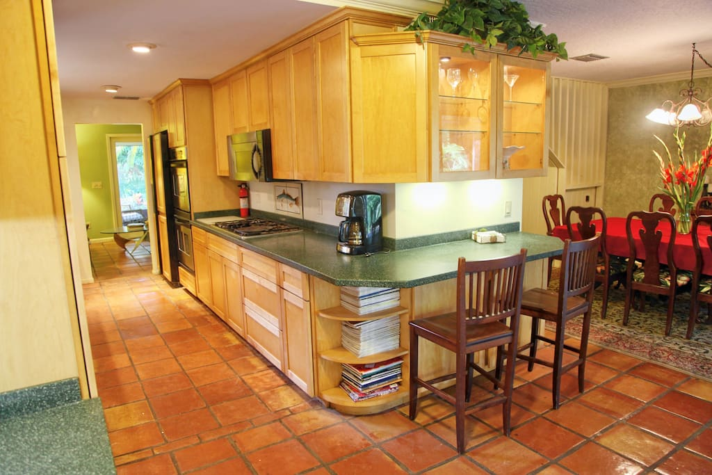 Kitchen has gas cooktop, dual convection oven, breakfast nook