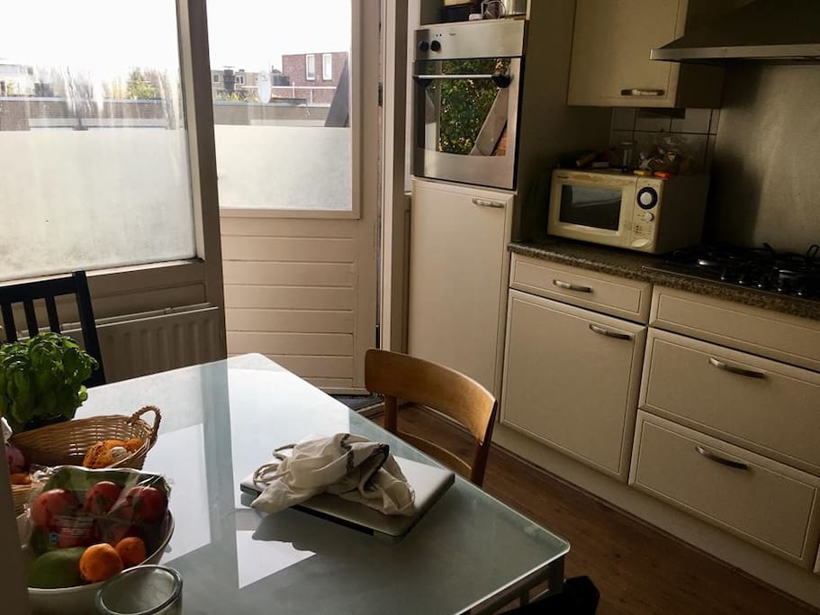 Kitchen with oven, stove, microwave, kettle, private refrigerator for guests, fully equipped