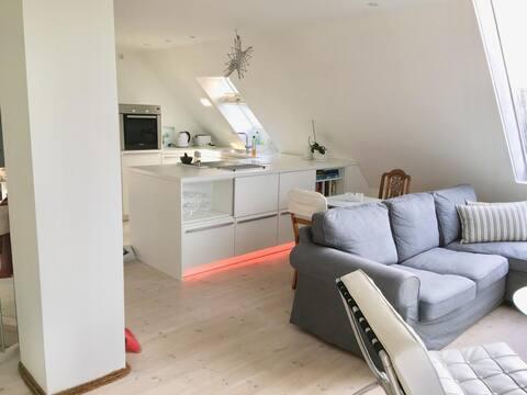 Bright attic apartment to the Baltic sea