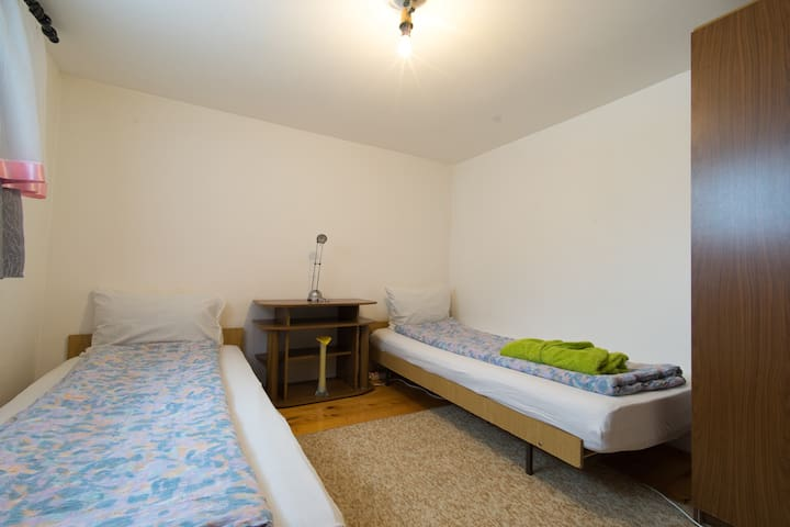 Two single beds with new mattresses,but can be put together