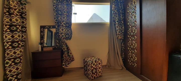 Entire bedroom With pyramids view