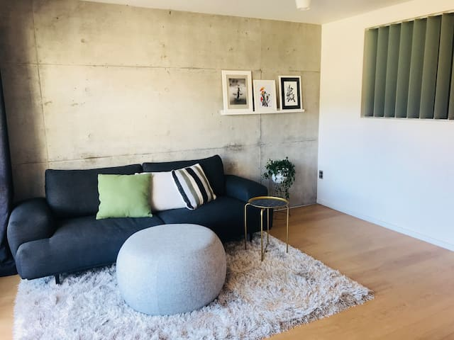 Cosy lounge with exposed concrete