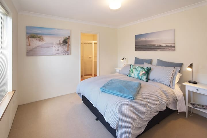 The spacious master bedroom has a Queen bed and ensuite bathroom.