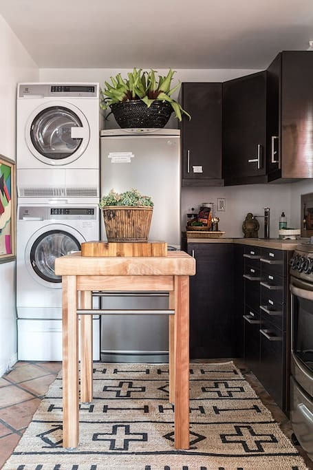 A full kitchen (fridge, oven/stove, microwave, sink) includes everything you might need for putting a great meal together. (And we have a semi stocked fridge for you!). This is also where your private washer/dryer is.