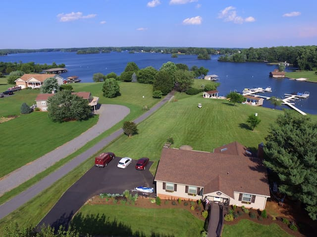 Drone pic looking from front of home to boathouse.