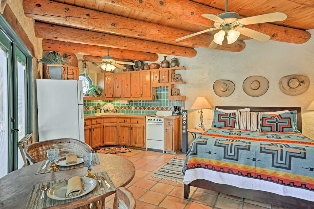 This adobe-style studio features exposed beams and tasteful southwestern decor.