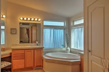 Soak your sun-kissed legs in the large soaking tub.