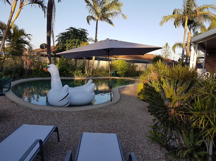 Outdoor area with pool and pergola area