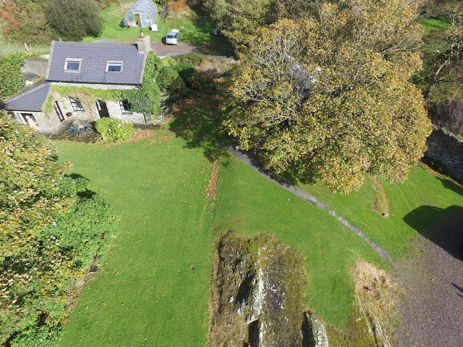 Ariel photo of the Cottage set in beautiful autumnal landscaped gardens