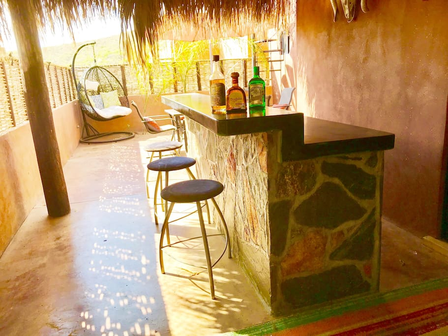 Outdoor bar area with sink.