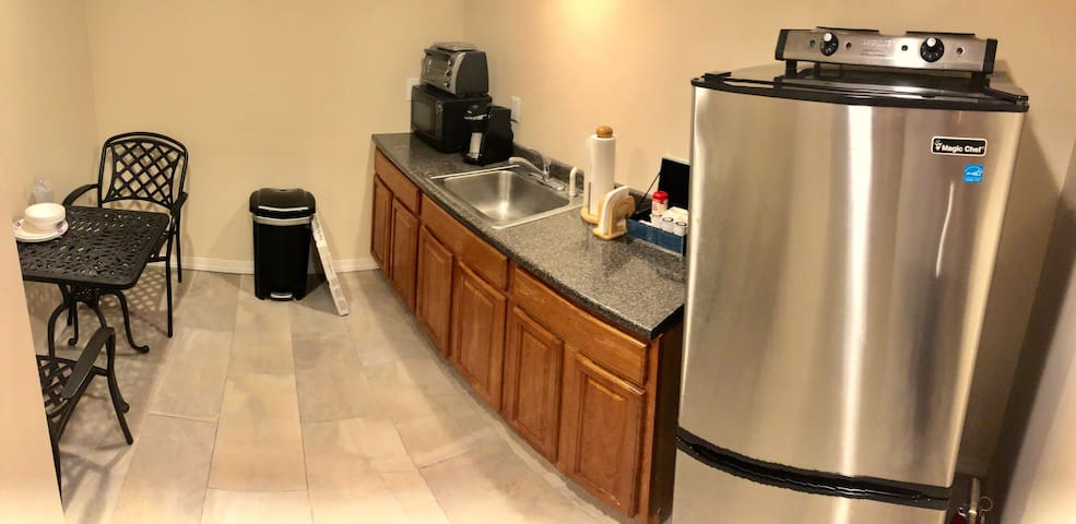 A well maintained kitchen comes with complimentary  K-Cups and water bottles for your stay!
