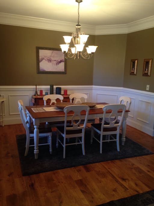 Open Dining room that easily sits 8 people.