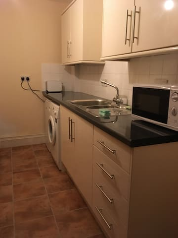 Basic kitchen area for you to prepare breakfast. Includes kettle, toaster, microwave, gadget for boiling or poaching eggs and fridge.