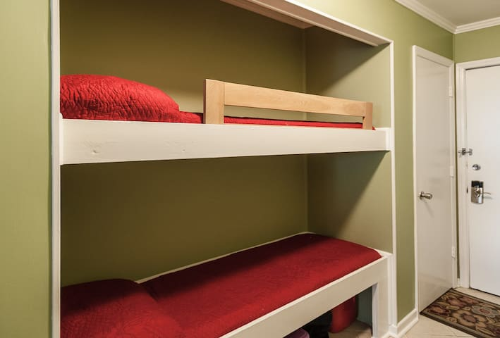 The ladder is in the closet to get up to the top bunk!