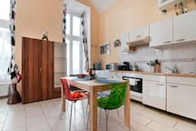 "Big kitchen for self-service including coffee machine.  Features beautiful colorful Calligaris Italian designer ""ice"" chairs!"