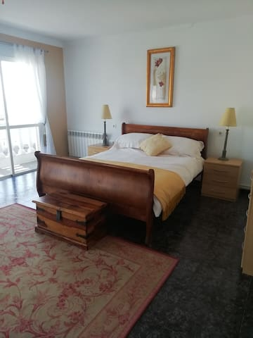 deluxe double with balcony leading directly to a very large terrace/access to the street and parking