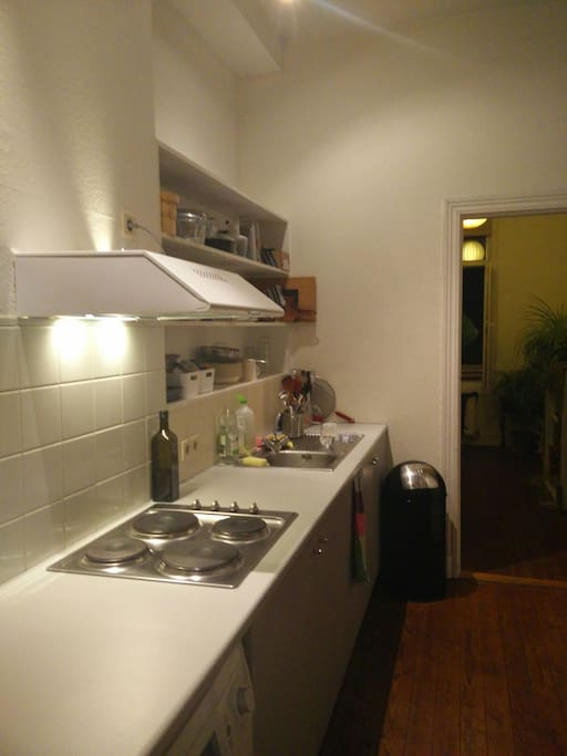 kitchen with microwave-oven combo, electric stove and washing machine