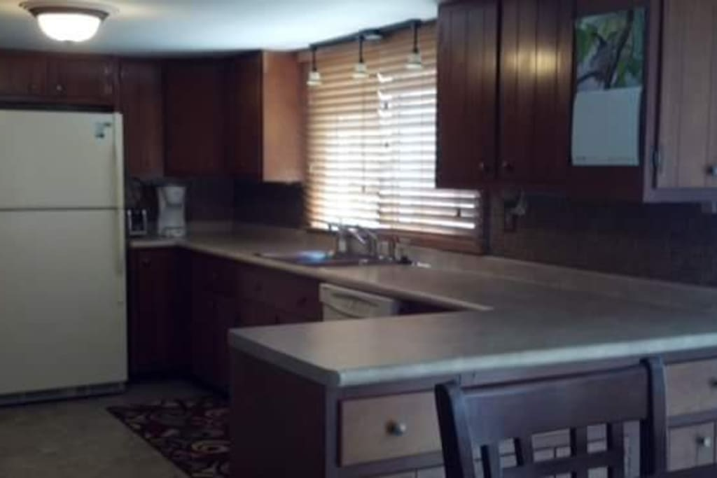 Eat in kitchen w/ full size appliances including dishwasher.