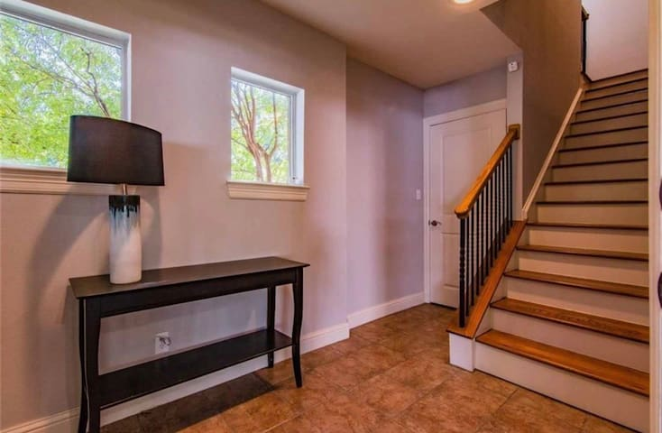 Lovely entryway/mudroom where you'll be greeted with house slippers so you can get nice and cozy during your stay.