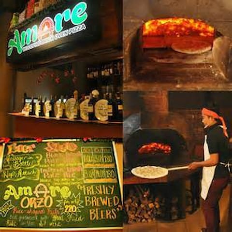 Enjoy the taste of well-known Amare Pizza, located just one floor below the unit