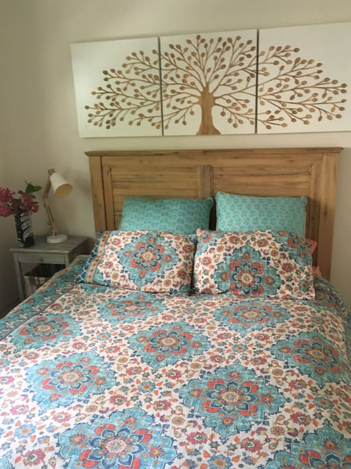 Cosy Queen Bed with Goose Down Doona and beautiful bedding