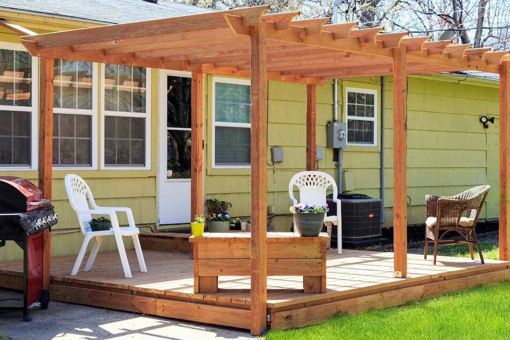 Newley built pergola/deck with plenty of seating for friends & family get togethers. Patio has a grill attached for guest use and leisure seating area and firepit.